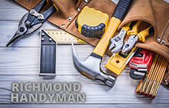 Maple Ridge Handyman picture of various tools lying on green grass forming the shape of a house.
